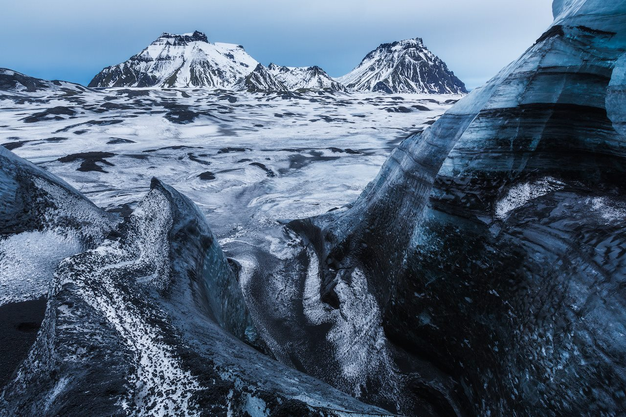 The white ice of Mýrdalsjökull glacier on the South Coast is streaked with ribbons of black volcanic ash.