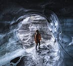 A traveller marvels at an ice cave in South Iceland