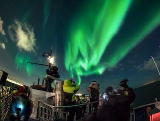 Excursión en barco para ver auroras boreales desde Reykjavík