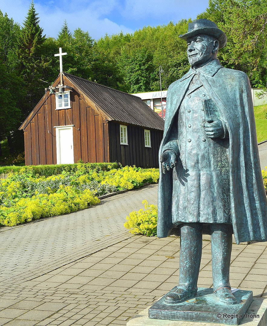 The Nonni statue by Nonnahús - and Minjakirkjan in Akureyri