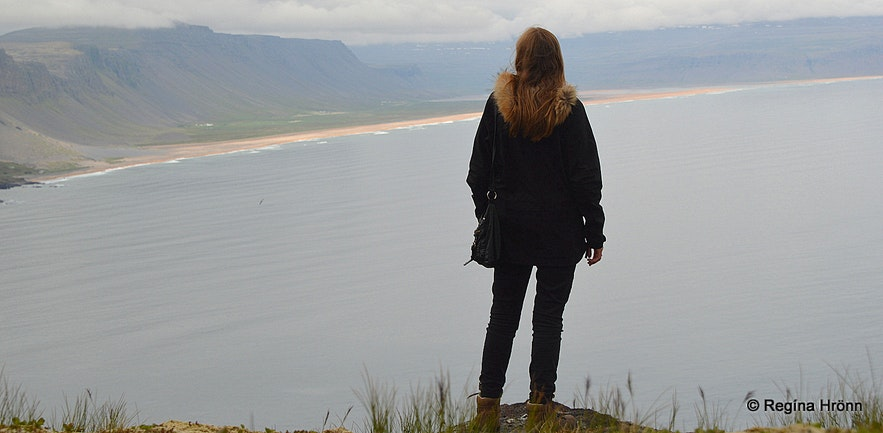 Regína admiring the view from Keflavíkurbjarg cliffs
