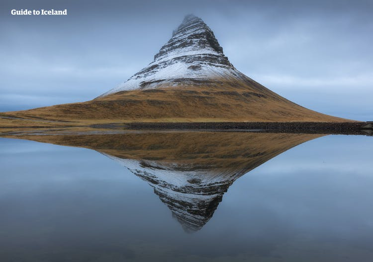 On a still winter day in Iceland, Mount Kirkjufell reflects beautifully in the sea.