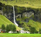 A waterfall on the Icelandic South Coast in summertime.