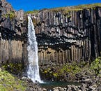 Svartifoss waterfall surrounded by hexagonal basalt columns in the Skaftafell National Park, South Iceland.