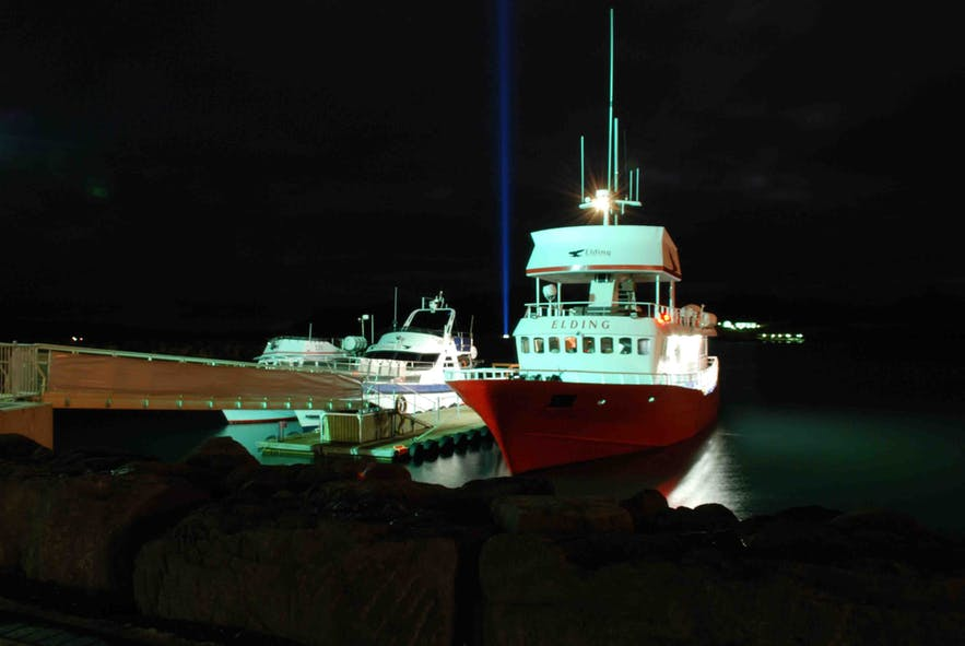 Boats ferry guests from Reykjavik to see the Imagine Peace Tower throughout the year.