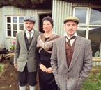 People in clothing traditionally worn during the 1920's in rural Iceland.