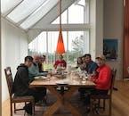Travellers at lunch, at Hraðastaðir farm in South Iceland.