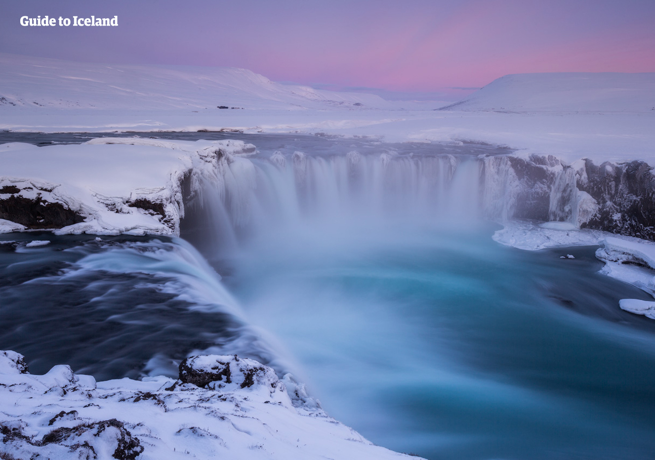 The stunning Goðafoss waterfall blanketed with snow.