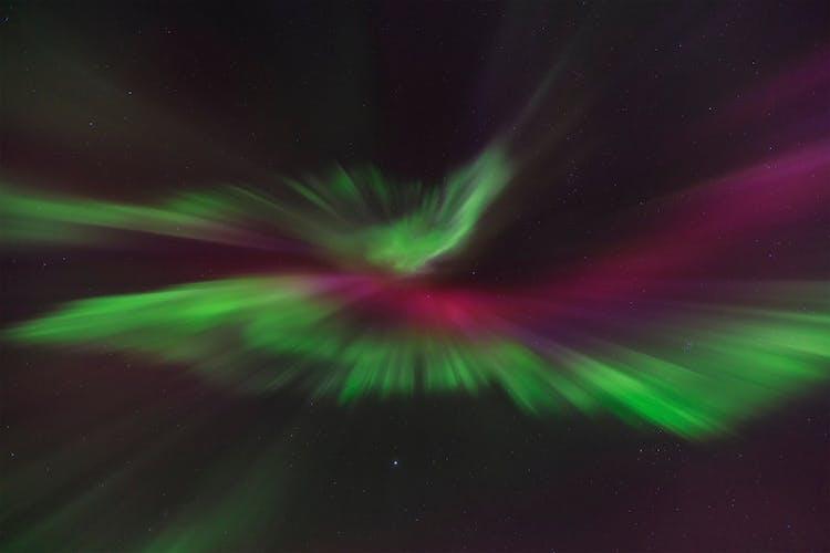 The multi-coloured Northern Lights illuminate the winter night sky,