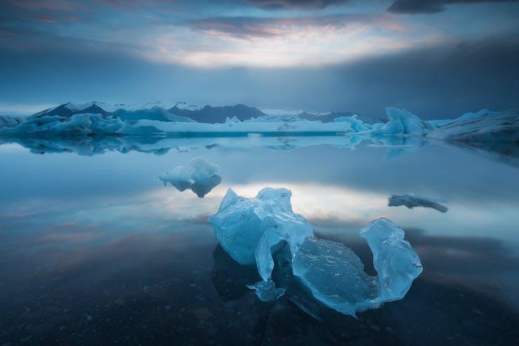 Icebergs float across Jökulsárlón glacier lake.