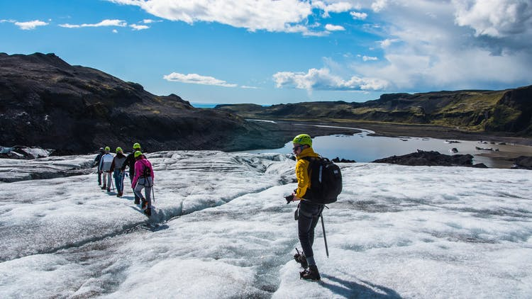 People hiking across a glacier in the South of Iceland.