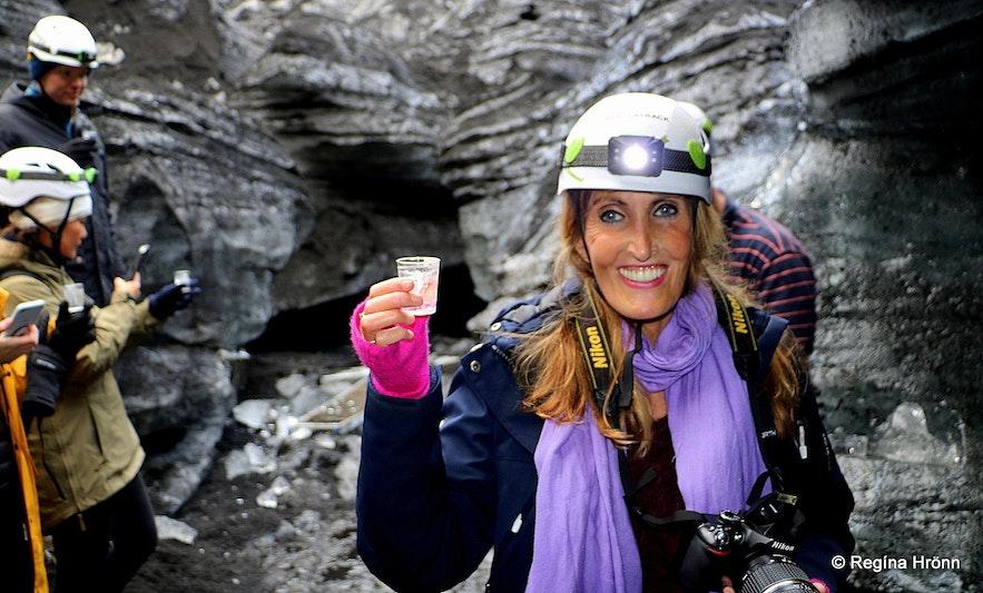 Regína having a drink inside the Katla ice cave South-Iceland