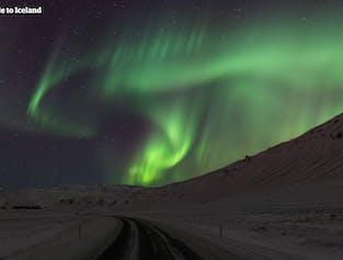 Chasse aux aurores boréales | Sortie en Super jeep avec un photographe