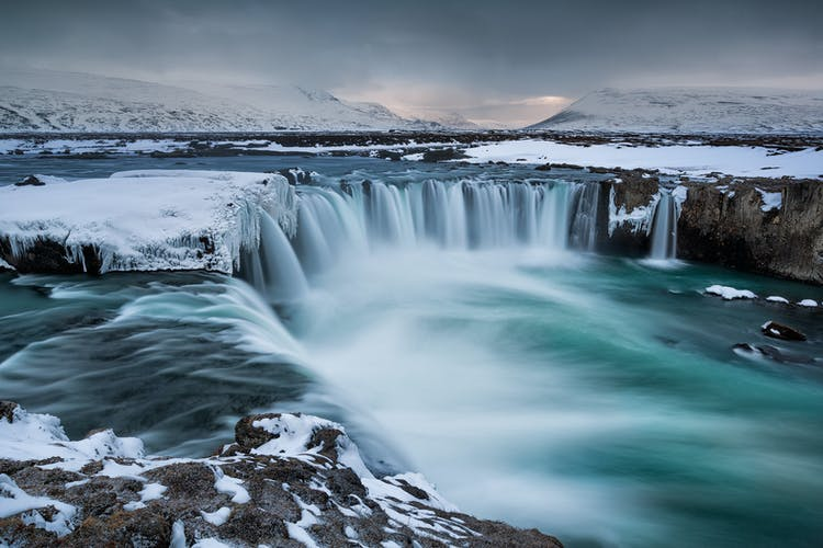 Goðafoss waterfall in North Iceland, bound in ice in high winter.