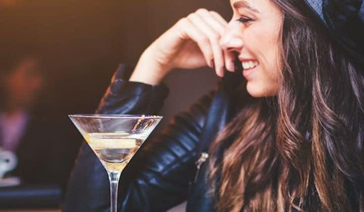A woman enjoying a drink at a bar.