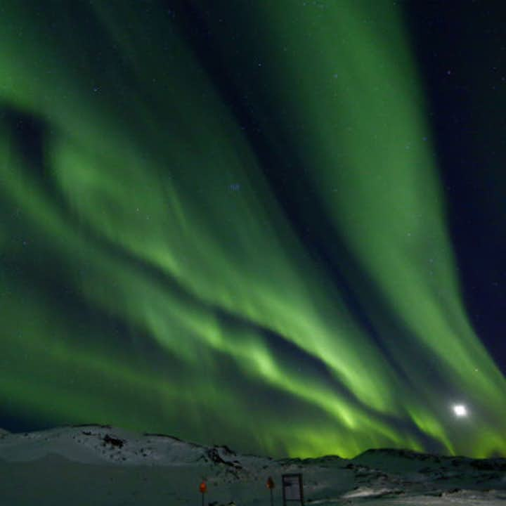 The northern lights above a snow covered vista