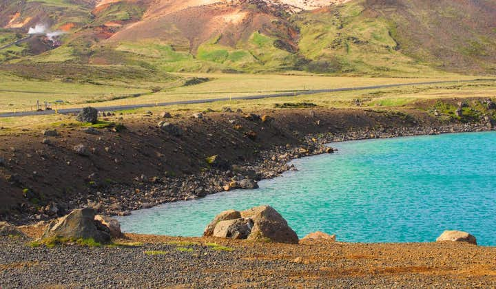 A beautiful blue cove with mountainous terrain behind it, Iceland