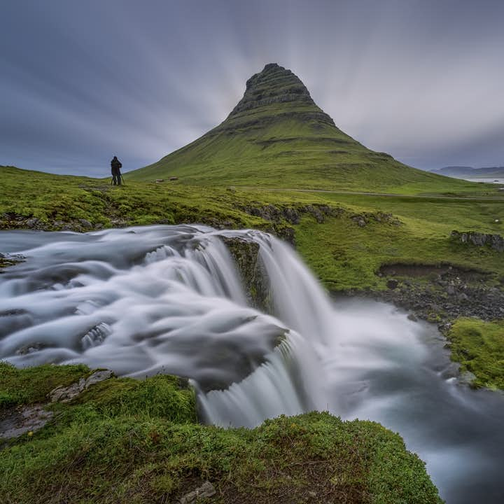 stark and imposing mount kirkjufell covered with moss
