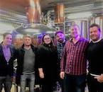 A group of travellers inside the Bryggjan Brugghús brewery center.