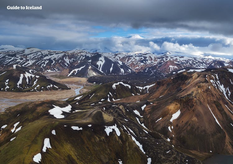 Even in the heights of summer in Iceland, under the midnight sun, the peaks of the mountains in highland locations such as Landmannalaugar are covered in snow and ice.
