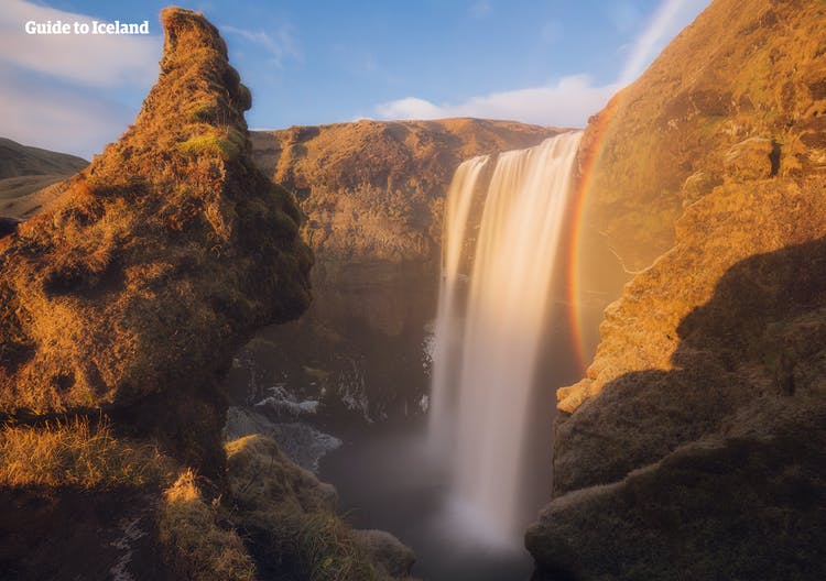 At the end of the Laugavegur trail through the Icelandic highlands is the much beloved South Coast waterfall, Skogafoss, pictured in summer.