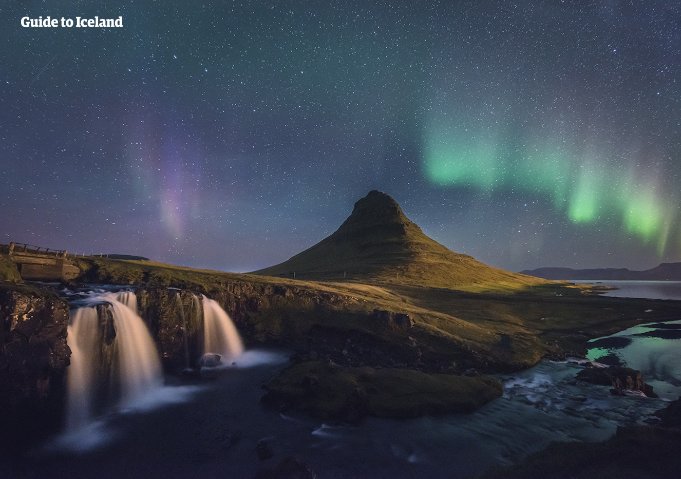 The fabulous Northern Lights dance across the sky behind one of the most photographed mountains, Mount Kirkjufell on the Snæfellsnes Peninsula.