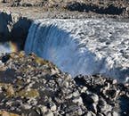 Dettifoss waterfall is enveloped by amazing rock formations that only add to the cascade's dramatic appearance.