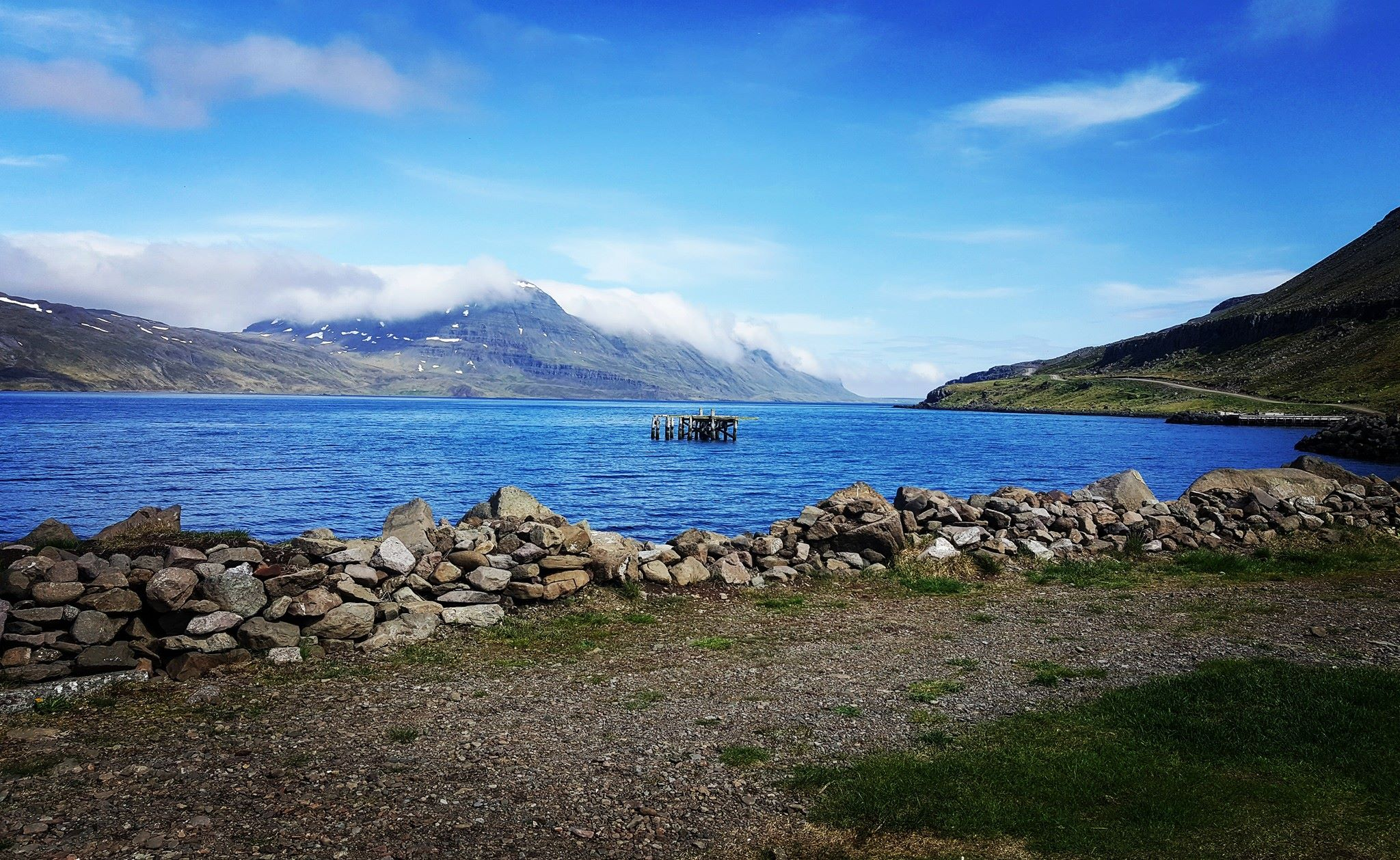 A broken down pier in an small village in the Westfjords.