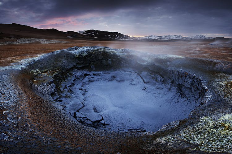 The Northern Lights dancing over a geothermal area near Lake Mývatn.