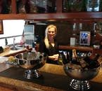 A woman assisting at the bar on the whale watching tour on a lovely luxury yacht from Reykjavík.
