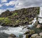 Magnificent panorama of stark rock formations and a creek in Þingvellir