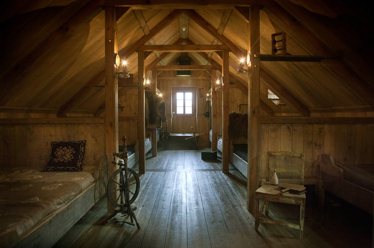 The intimate and comfortable baðstofe, the traditional room where people slept and worked in old Icelandic farms.