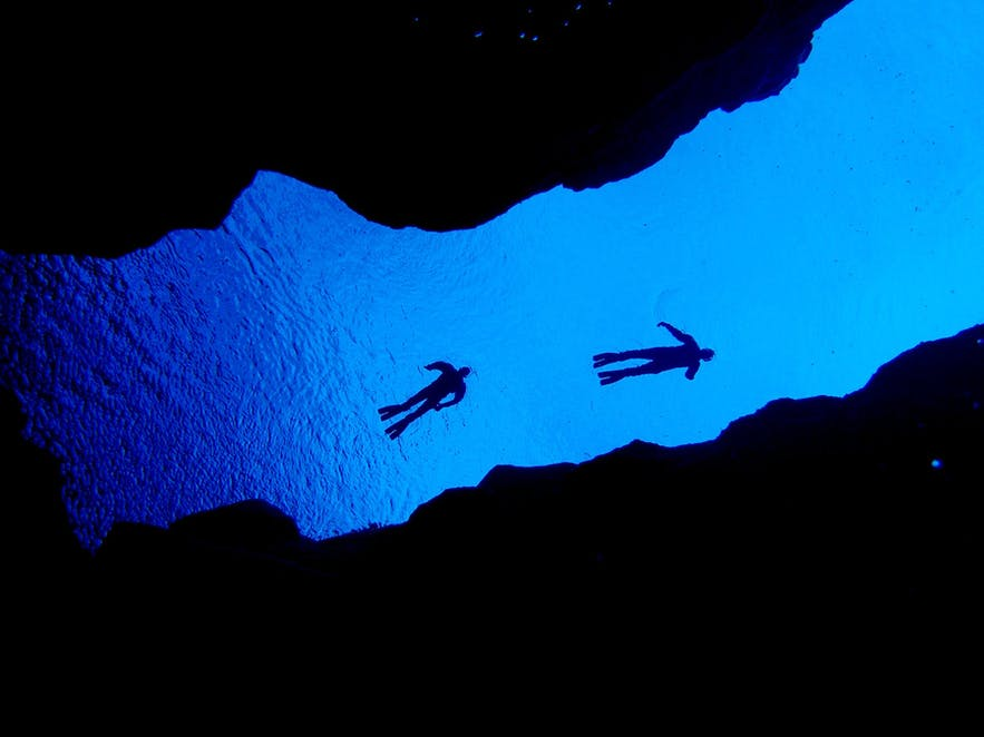 Snorkel between two continents in Silfra fissure.