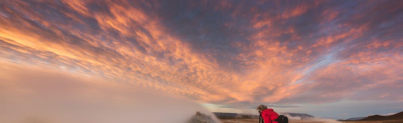 A photographer captures the scene at Námaskarð Pass.