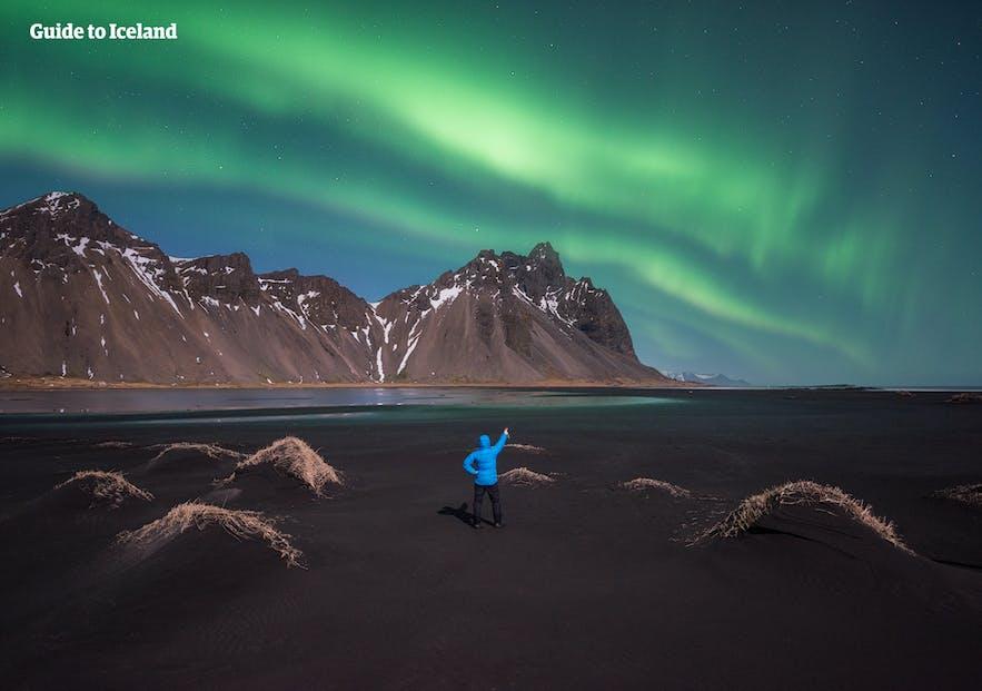 A solo traveller by Mt Kirkjufell.