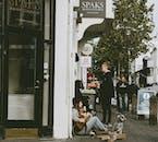 A man playing a guitar on Laugavegur street, Reykjavík downtown.