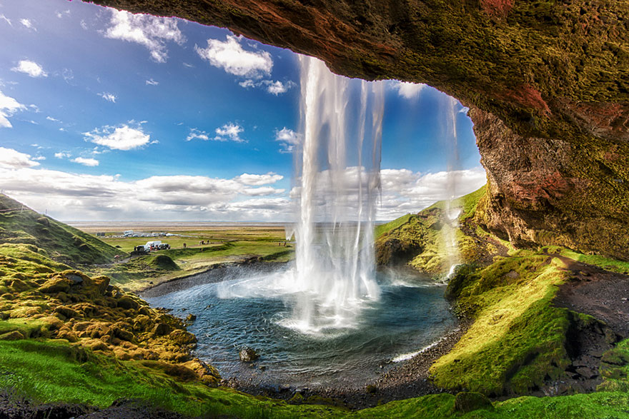 Behind the falling water at Seljalandsfoss waterfall on Iceland's South Coast.