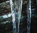 The stripes of the path of water around the icicle are visible, even after the whole things freezes solid.