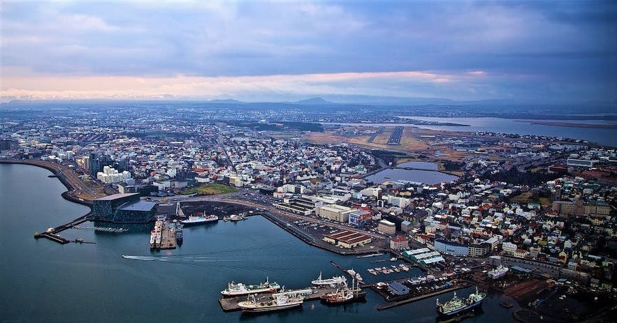 An aerial perspective over Reykjavík city, as can only be seen from the window of a helicopter.