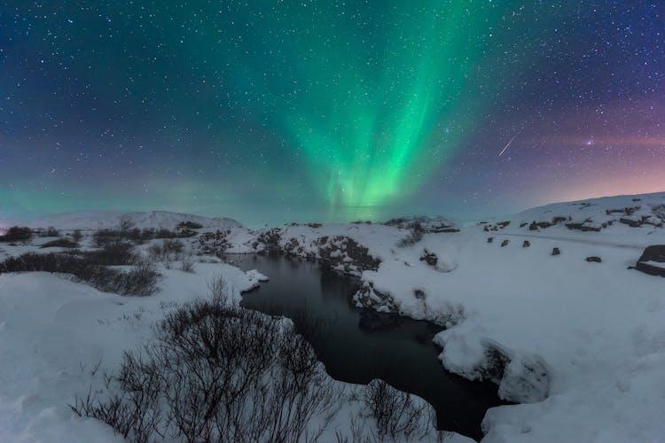Northern Lights play across the winter sky.
