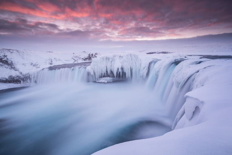 Goðafoss waterfall is mysterious looking in its icy coating.
