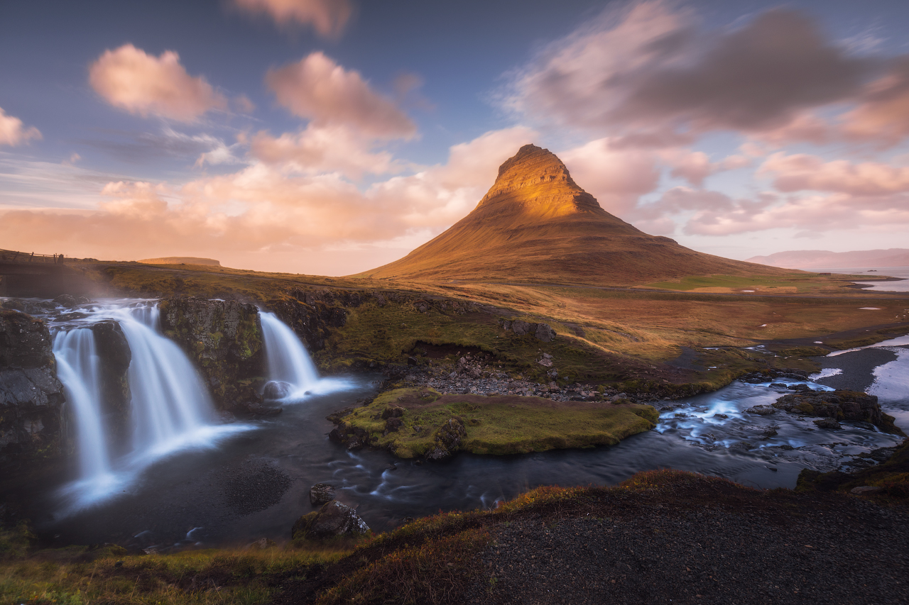 A stunning autumnal shot of Iceland' most photographed mountain, Kirkjufell, reflected on the water's surface.