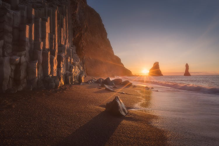 Reynisfjara black sand beach, as caught under an early morning sunrise.