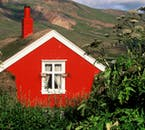 A red painted turf house in Borgarfjörður Eystri, east Iceland.