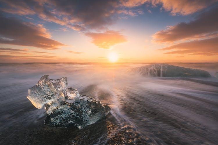 The midnight sun shining on the icebergs at the Diamond Beach.
