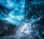 The Ice caves are formed when glacial water melts into rivers, braking through the ice.