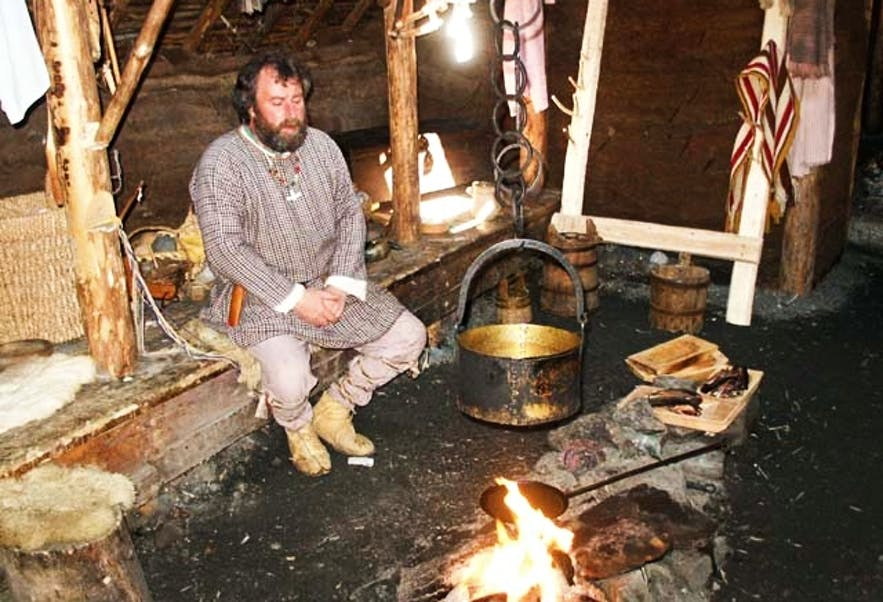 A traditional Norseman enjoying the comforts of his home.