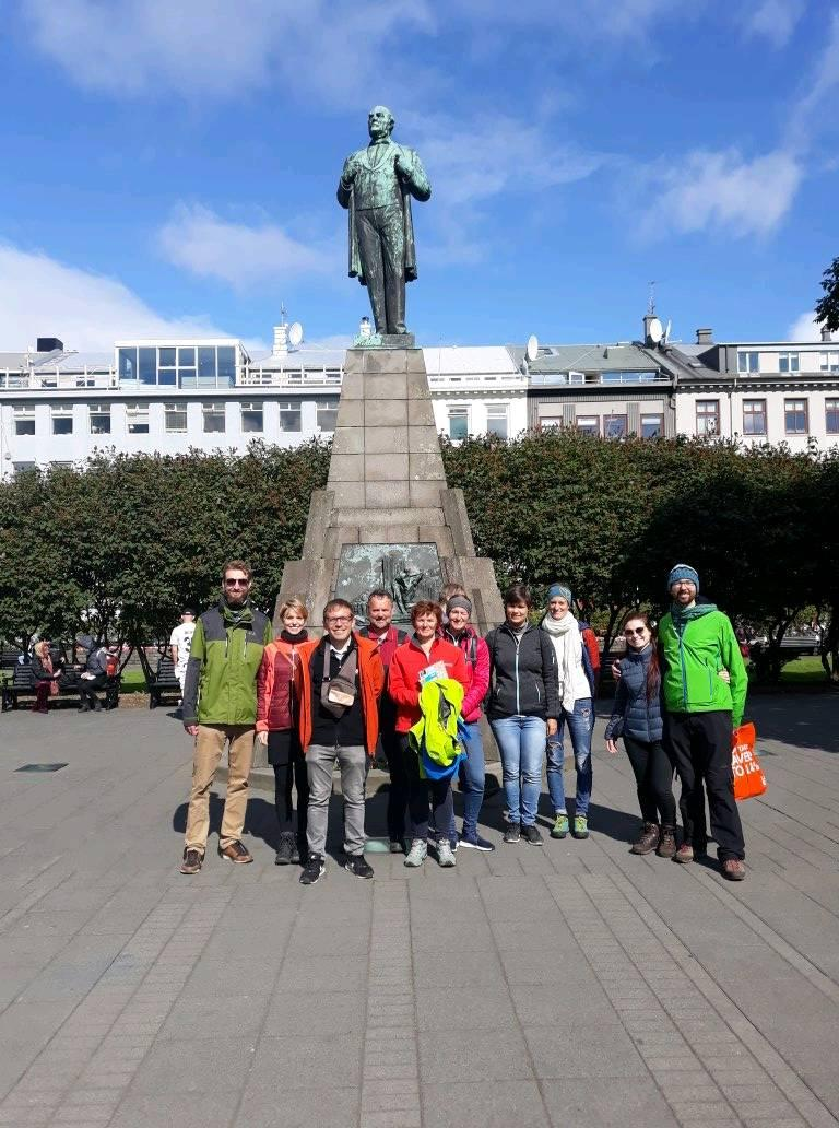 A group meeting by the statue of Jón Sigurðsson, Iceland's independence hero.