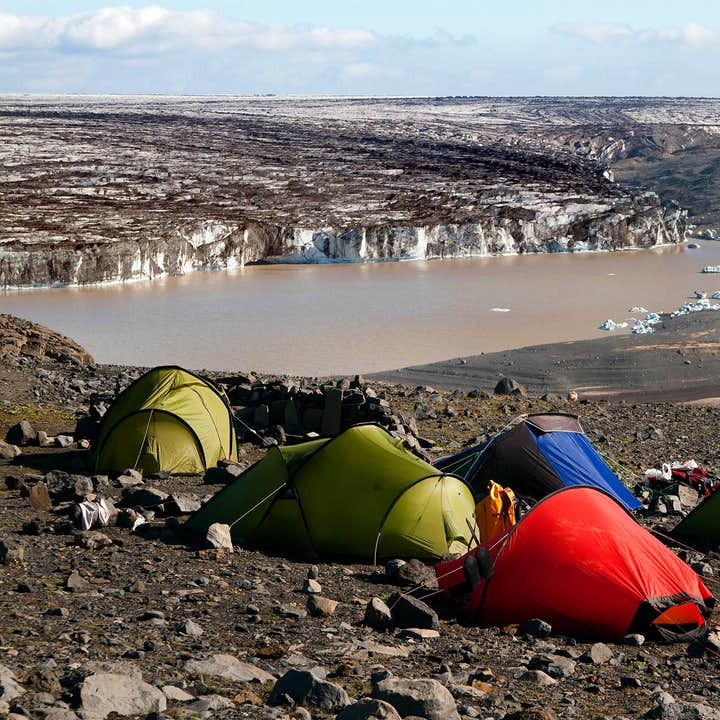 Camping on the edge of a mountain glacier lagoon, far away from any settlements.