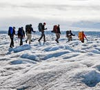 A group hiking over a glacier on their way to the Skaftafell national park.